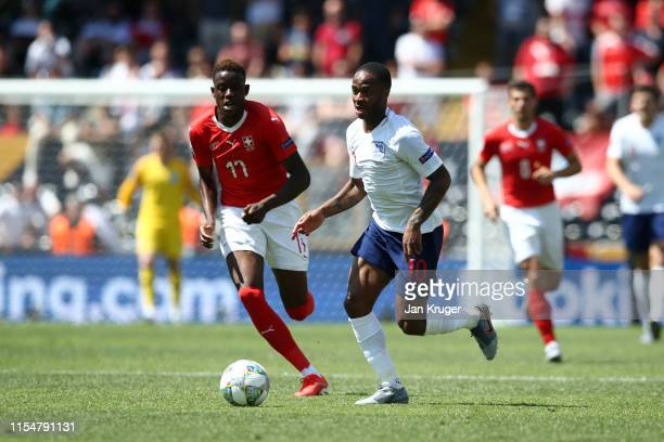 Denis Zakaria of Switzerland battles for possession with Raheem Sterling of England during the UEFA Nations League Third Place Playoff match between...