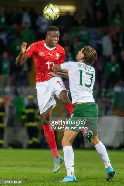 Denis Zakaria of Switzerland battles for the ball with Jeff Hendrick of Republic of Ireland during the UEFA Euro 2020 qualifier between Switzerland...