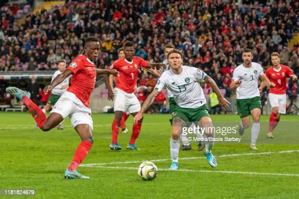 Denis Zakaria of Switzerland battles for the ball with Jeff Hendrick of Republic of Ireland the UEFA Euro 2020 qualifier between Switzerland and...