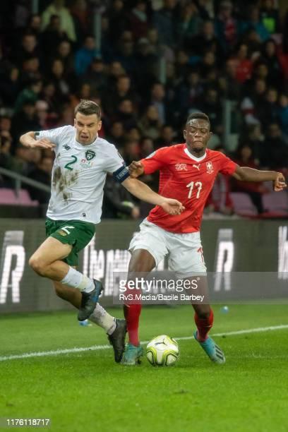 Denis Zakaria of Switzerland battles for the ball with Seamus Coleman of Republic of Ireland during the UEFA Euro 2020 qualifier between Switzerland...