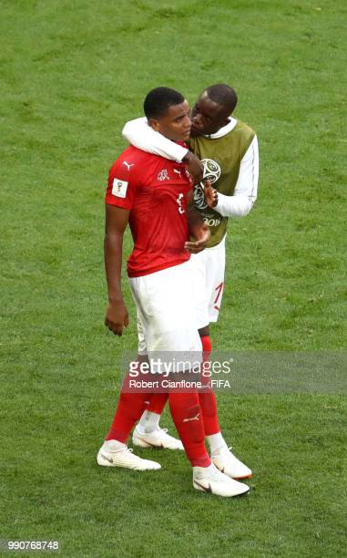 Denis Zakaria of Switzerland consoles teammate Manuel Akanji of Switzerland following their sides defeat in the 2018 FIFA World Cup Russia Round of...