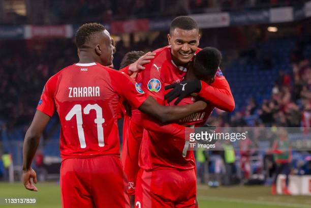 Denis Zakaria of Switzerland Manuel Akanji of Switzerland and Breel Embolo of Switzerland celebrate after their team's third goal during the 2020...