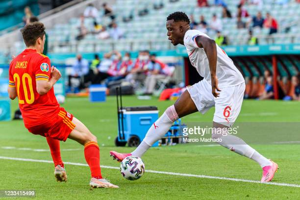 Denis Zakaria of Switzerland plays against Daniel James of Wales during the UEFA Euro 2020 Championship Group A match between Wales and Switzerland...