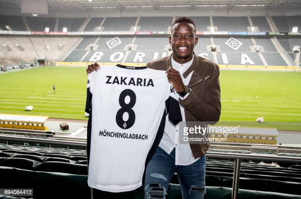 Denis Zakaria pose with his new jersey after signing a contract with Borussia Moenchengladbach at Borussia-Park on June 09, 2017 in Moenchengladbach,...
