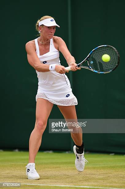 Denisa Allertova of Czech Republic plays a backhand in her match against Caroline Wozniacki of Denmark during their Women's Singles Second Round...