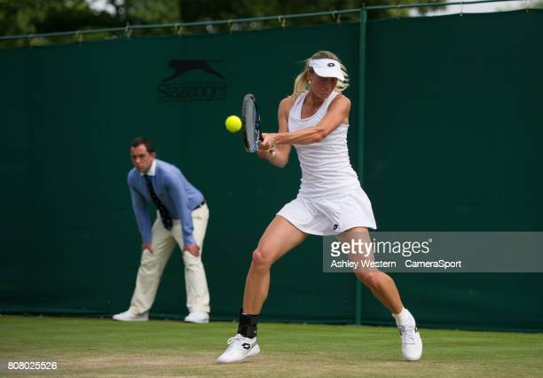 Denisa Allertova of The Czech Republic in action during her victory over Lisa Ozaki of Japan in their Ladies' Singles First Round Match at Wimbledon...