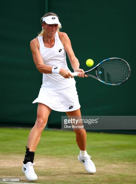 Denisa Allertova of the Czech Republic plays a backhand during the Ladies Singles first round match against Risa Ozaki of Japan on day two of the...