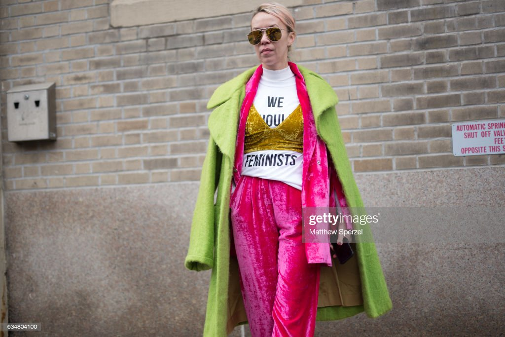 Denisa Palsha is seen attending Creatures of the Wind during New York Fashion Week wearing a statement outfit with green coat, pink jacket and pants, and gold top on February 11, 2017 in New York City.