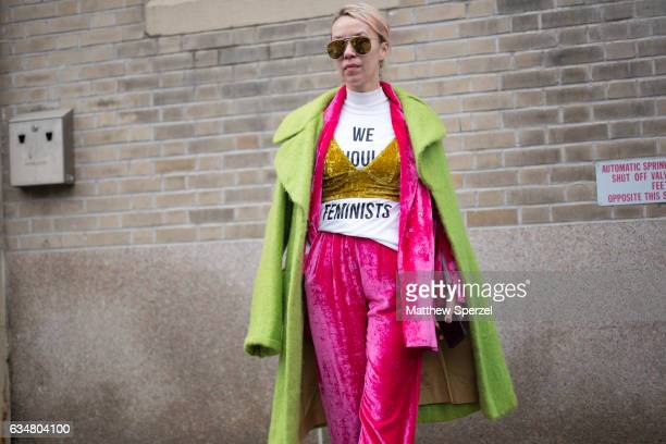 Denisa Palsha is seen attending Creatures of the Wind during New York Fashion Week wearing a statement outfit with green coat pink jacket and pants...
