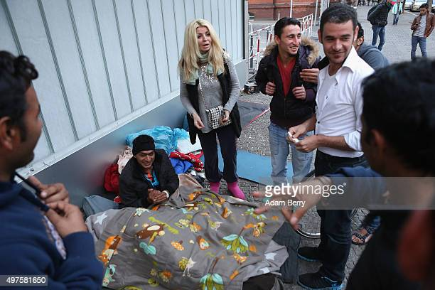 Denise a Bosnian woman on vacation from Dubai stops to visit migrants outside the LaGeSo State Office for Health and Social Services the office for...