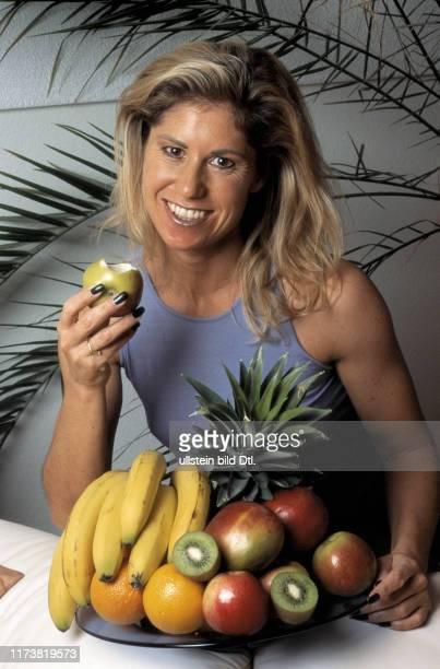 Denise Biellmann eating fruit