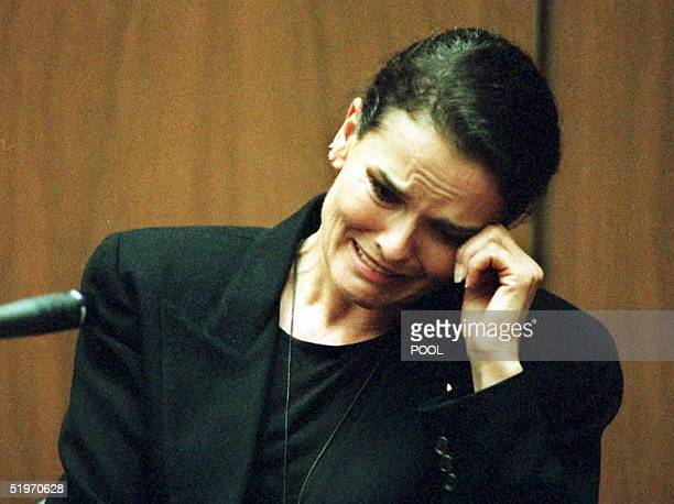 Denise Brown sister of murder victim Nicole BrownSimpson cries as she testifies on the witness stand during the OJ Simpson murder trial 03 February...