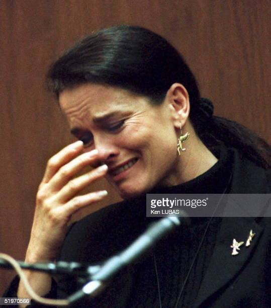 Denise Brown the sister of murder victim Nicole Brown cries on the witness stand 06 February in Los Angeles during testimony about her sister's...