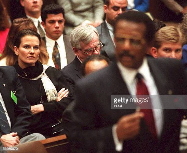 Denise Brown the sister of murder victim Nicole Brown Simpson watches as defense attorney Johnnie Cochran Jr delivers the defense's opening...