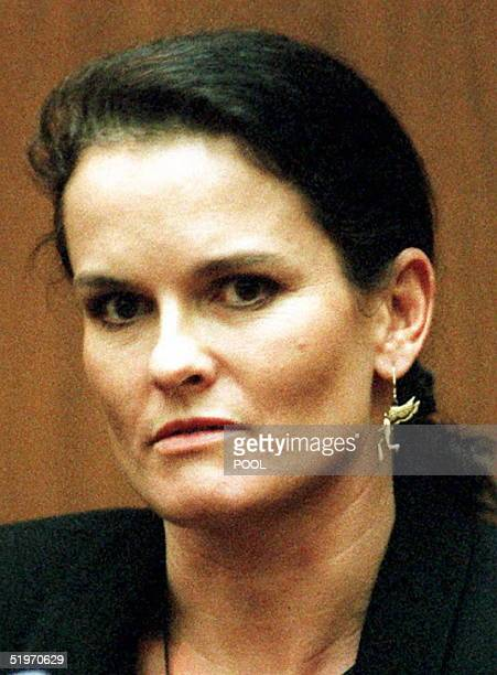 Denise Brown wears an angel earring in memory of her slain sister Nicole Brown Simpson while testifying 03 February during the OJ Simpson murder...