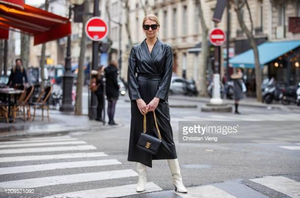 Denise Buschkühle is seen wearing black vegan leather dress Nanushka, white Zara boots, Burberry bag, Bottega Veneta sunglasses outside Balmain...