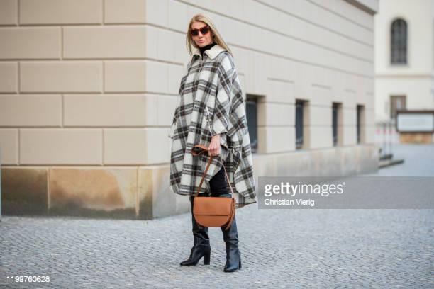 Denise Buschkühle is seen wearing checkered cape Isabel Marant, brown bag Numen, black boots Red Valentino, Bottega Veneta sunglasses during the...