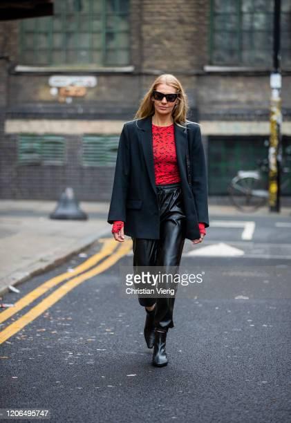 Denise Buschkühle is seen wearing top Preen Le Apt black pants other Stories blazer By Far boots Demellier London bag Le Specs sunglasses outside...
