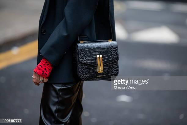 Denise Buschkühle is seen wearing top Preen Le Apt black pants other Stories blazer Demellier London bag Le Specs sunglasses outside Marques Almeida...