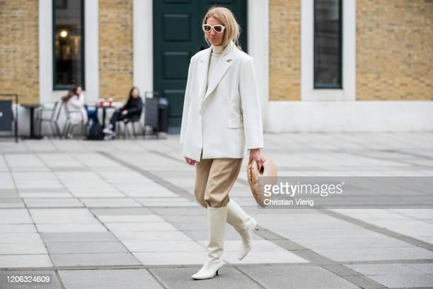 Denise Buschkühle is seen wearing white blazer Pixie Market, pants Totem, body Loulou Studio, Zimmerann sunglasses, camel bag A.W.A.K.E. During...