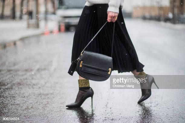 Denise Buschkuehle wearing white knit Sandro black Valentino bag black Zara skirt By Malene Birger socks Michael Kors pumps is seen during the Berlin...
