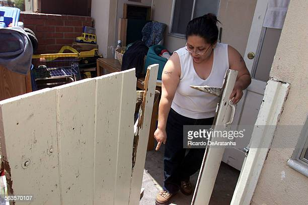 Denise Caballero a resident at Mira Loma Apartments in Oxnard points to a nail of a broken gate that she says cut her 2–year–old daughter's leg She...