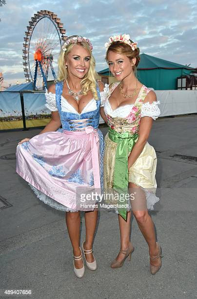 Denise Cotte and Jessica Kuehne attend the Almauftrieb during the Oktoberfest 2015 at Kaefer Tent on September 20 2015 in Munich Germany