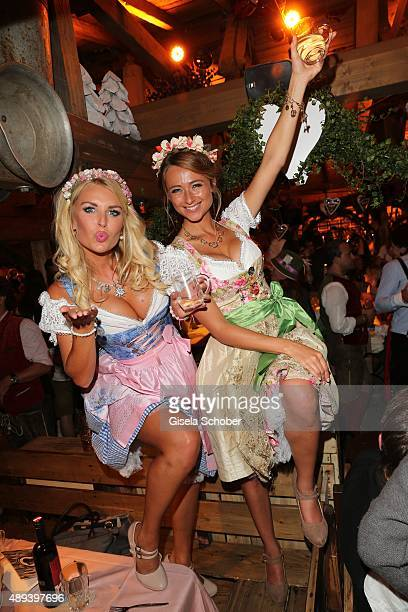 Denise Cotte and Jessica Kuehne Wiesn Playmate attend the Almauftrieb during the Oktoberfest 2015 at Kaeferschaenke beer tent on September 20 2015 in...