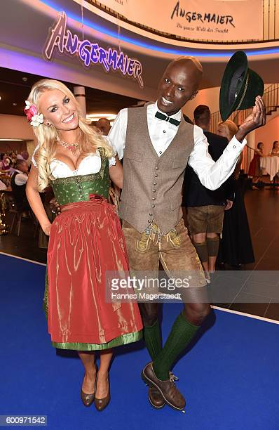 Denise Cotte and Papis Loveday during the Angermaier Kicks Off Oktoberfest Season With 'TrachtenNacht' on September 8 2016 in Munich Germany