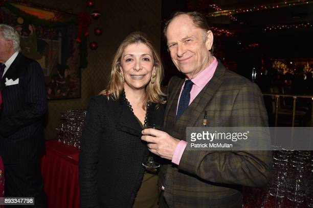 Denise DeLuca and Gordon Roberts attend A Christmas Cheer Holiday Party 2017 Hosted by George Farias Anne and Jay McInerney at The Doubles Club on...