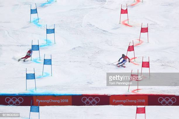 Denise Feierabend of Switzerland and Adeline Baud Mugnier of France compete during the Alpine Team Event Semifinals on day 15 of the PyeongChang 2018...
