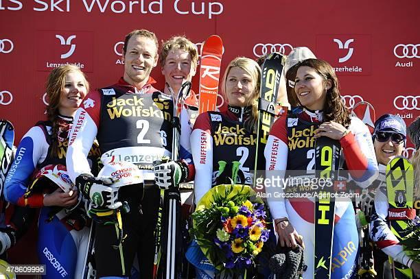 Denise Feierabend Wendy Holdener Luca Aerni Reto Schmidiger of Team Switzerland take 1st place during the Audi FIS Alpine Ski World Cup Nation's Team...