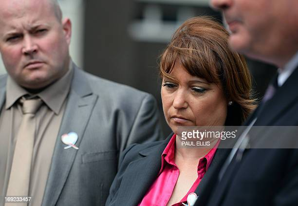 Denise Fergus listens with with her husband Stuart as solicitor Sean Sexton reads a statement after a parole hearing for Jon Venables by video link...