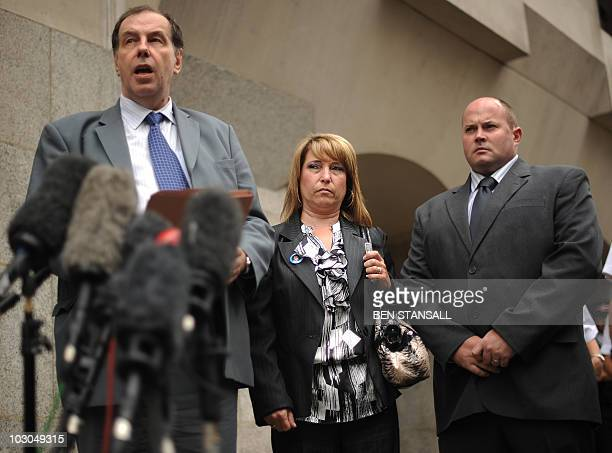 Denise Fergus mother of murdered British toddler James Bulger and her husband Stuart Fergus look on as spokesmen Chris Johnson reads a statement...