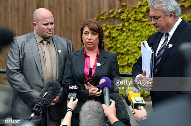 Denise Fergus stands with her husband Stuart and lawyer Sean Sexton as she speaks to the press after addressing a parole hearing for Jon Venables by...