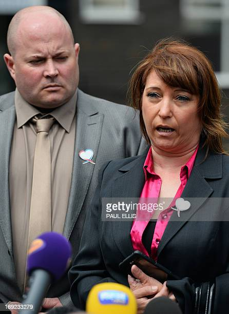 Denise Fergus stands with her husband Stuart as she speaks to the press after addressing a parole hearing for Jon Venables by video link from Crosby...