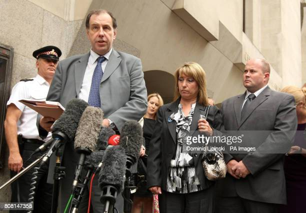 Denise Fergus the mother of James Bulger and her partner Stuart Fergus listen to spokesman Chris Johnson as he reads a statement outside the Old...