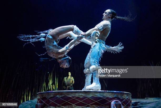Denise Garcia Sorta and Massimiliano Medini perform on stage for the Cirque du Soleil 'Totem' show on March 22 2018 in Barcelona Spain