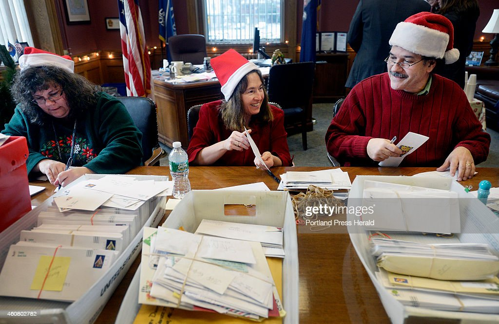Letters to santa are answered by volunteers at the main post office denise gonneville center shares a letter with fellow volunteer nick russo right spiritdancerdesigns Images