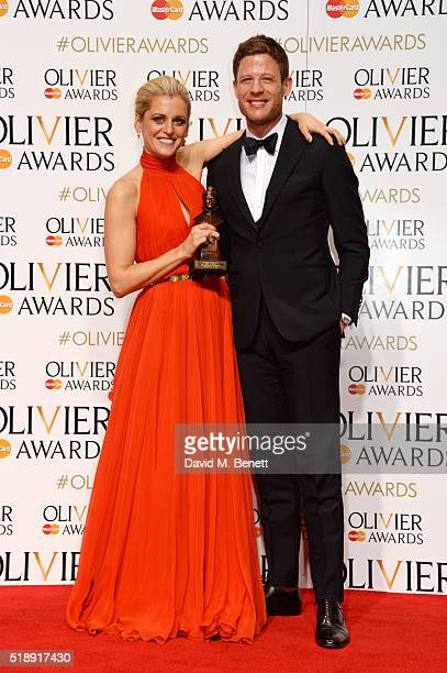 Denise Gough winner of the Best Actress award for 'People Places and Things' and presenter James Norton pose in the Winners Room at The Olivier...