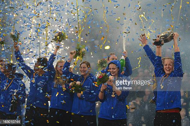 Denise Hanke of Schwerin lifts the trophy after winning the DVV German Woman's Cup Final match between Schweriner SC and VC Wiesbaden at Gerry Weber...