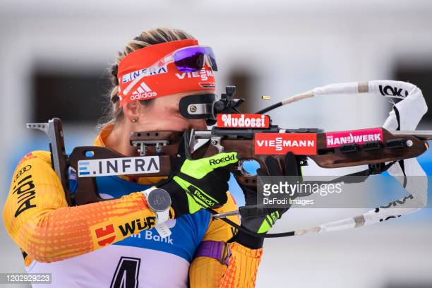 Denise Herrmann of Germany at the shooting range during the Women 12.5 km Mass Start Competition at the IBU World Championships Biathlon...