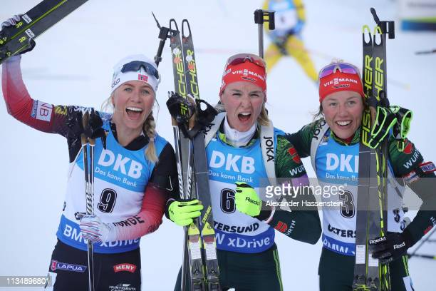 Denise Herrmann of Germany celebrates winning the gold medal ahead of Tirill Eckhoff of Norway and Laura Dahlmeier of Germany after the Women's 10km...