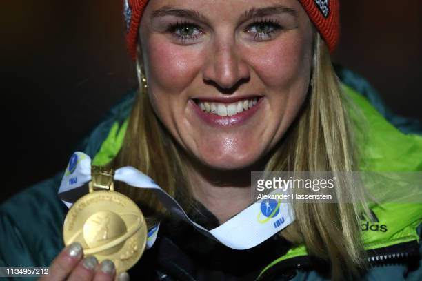 Denise Herrmann of Germany celebrates winning the Gold medal at the Medal Ceremony for the IBU Biathlon World Championships Women's Pursuit on March...