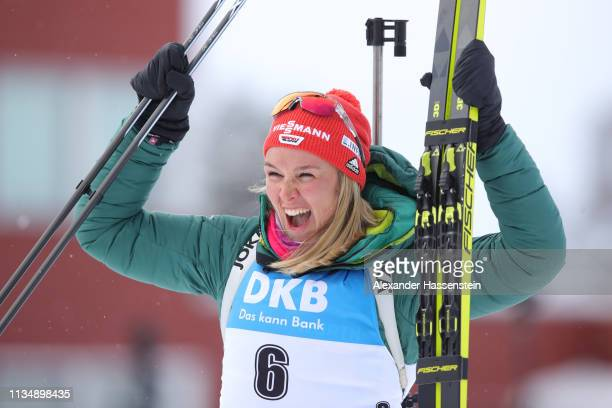 Denise Herrmann of Germany celebrates winning the gold medal during the flower ceremony following the Women's 10km Pursuit race at the IBU Biathlon...