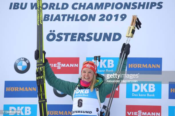 Denise Herrmann of Germany celebrates winning the gold medal during flower ceremony following the Women's 10km Pursuit race at the IBU Biathlon World...