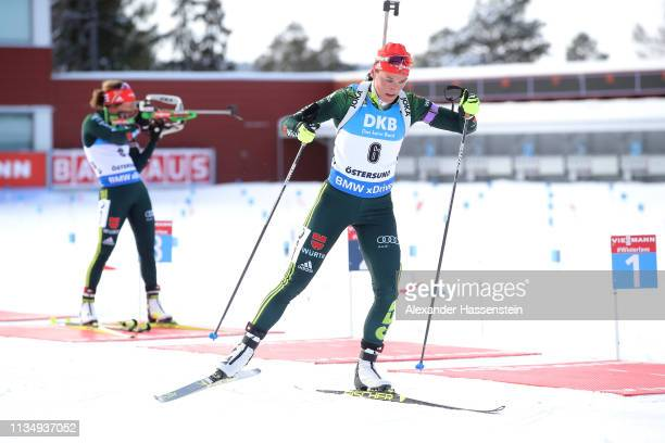 Denise Herrmann of Germany leaves the shooting range after the last shooting ahead of her team mate Laura Dahlmeier at the IBU Biathlon World...