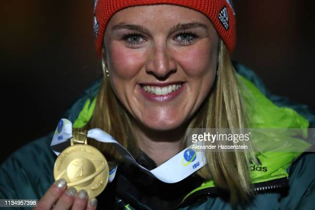 Denise Herrmann of Germany smiles after winning the IBU Biathlon World Championships Women's Pursuit at Swedish National Biathlon Arena on March 10,...