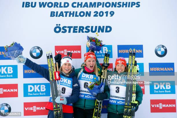 Denise Herrmann of Germany wins the gold medal Tiril Eckhoff of Norway wins the silver medal Laura Dahlmeier of Germany wins the bronze medal during...