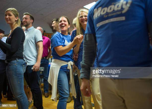 Denise Kaserman left of Falmouth and Karen Vachon of Scarborough reacts as favorable primary voting results are reported at a gathering at for...